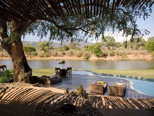 at-the-chongwe-river-house-in-zambia-you-can-relax-at-the-pool-while-watching-animals-come-to-bathe-and-drink-in-the-nearby-chongwe-river