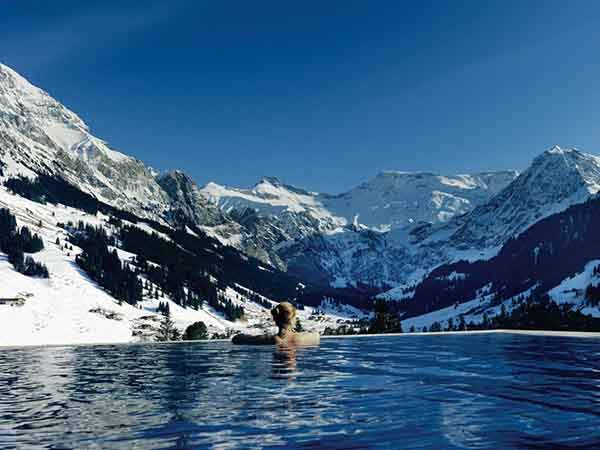 located-in-the-heart-of-the-swiss-alps-the-cambrian-hotel-offers-a-pool-with-awe-inspiring-views-of-the-alps