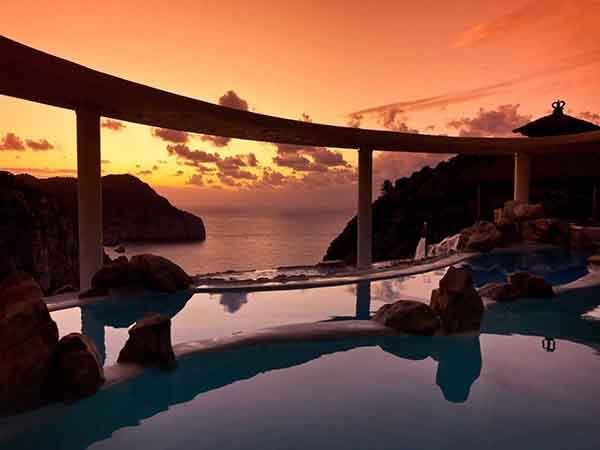the-hotel-haciende-na-xamena-resort-in-ibiza-spain-is-suspended-180-meters-at-the-top-of-a-cliff-to-offer-amazing-panoramic-mountain-and-sea-views