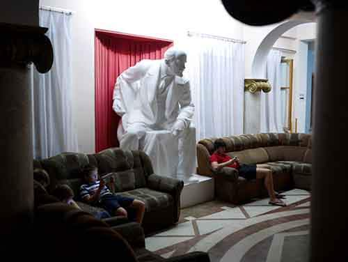 "Lenin looms over young Russians on their tablets and iphones in a soviet-era sanitorium in Gagra. An administrator said the statue, installed in the foyer in 1953, was popular with older Russian tourists, ""it's nostalgia, they have good memories of the Soviet Union."""