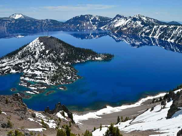 the-volcanic-basin-of-crater-lake-national-park-oregon-formed-nearly-8000-years-ago-at-almost-2000-feet-deep-the-lake-is-the-deepest-in-the-us