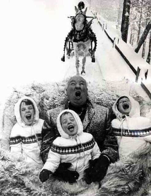 Alfred Hitchcock playing with his grandchildren, 1960.