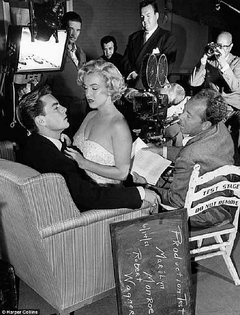 Robert Wagner with a seductive Marilyn Monroe on his lap during a test scene for Let's Make It Legal on June 14, 1951.