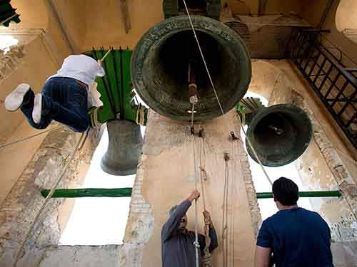 Bell ringers of Utrera perform on Palm Sunday at the beginning of Holy week in Santa Marta de la Mesa Church on April 13, 2014 in Utrera, Spain. Church Bell ringers of Utrera keep a tradition that is more than 500 years and are currently seeking to be included on UNESCO's