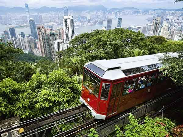 View of Peak Tram arriving at the top of the Victoria Peak. Victoria Peak, Hong Kong island, China