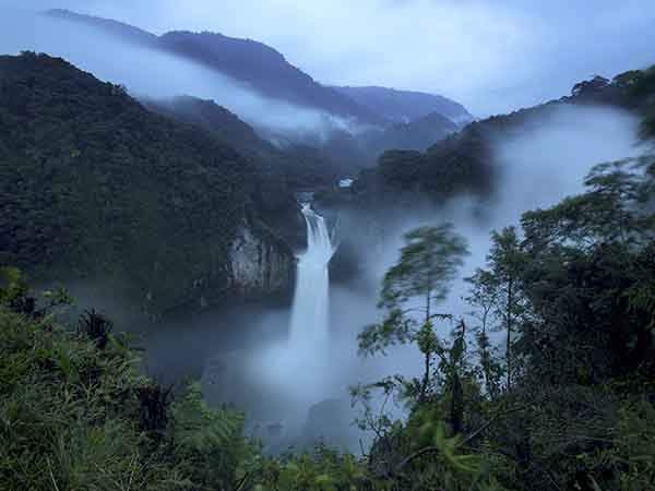 A few miles from the site of a hydroelectric plant, the Coca River vaults down a 480-foot waterfall, the tallest in Ecuador, March 6, 2015. China ? which has through state-owned banks already lent some $11 billion on Ecuadorean projects