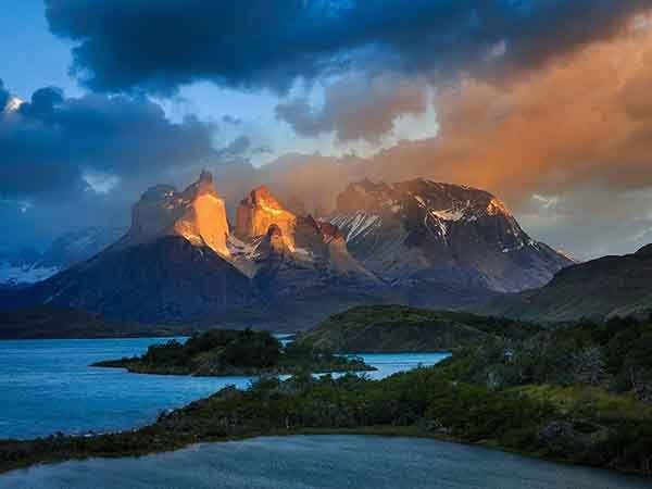 Torres Del Paine, Chilean Patagonia The famous Torres Del Paine centerpiece 243; Cuernos del Paine. This was the early morning sun hits the face of the mountain, and the dark stormy clouds glows and popes up! #chile #cuernos #lake #patagonia #pehoe #salto grande #south america #travel #Cuernos #TorresDelPaines #adventure #chile #clouds #light #national park #nature #canon #canonmk5d3 #outdoor #outdoors #patagonia500 #storm