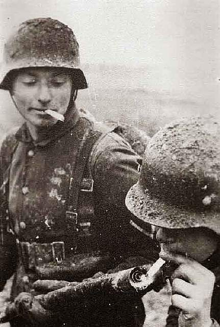 German soldier lights his cigarette with a flame thrower, 1940's