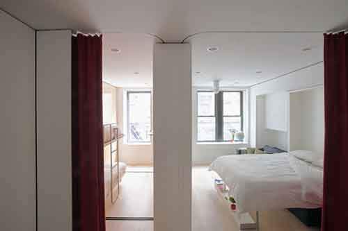 for-additional-privacy-from-the-kitchen-space-curtains-extend-from-cabinet-pockets-on-the-sides