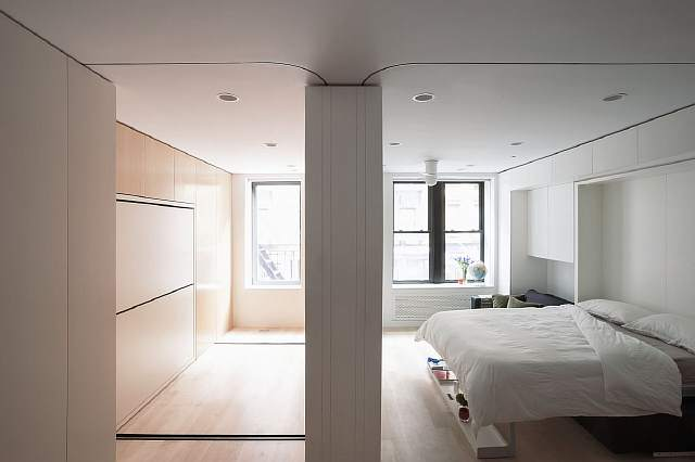 sandu-and-iancu-designed-the-space-to-have-various-essential-items-tucked-away-into-the-walls-this-extension-wall-created-an-additional-room-in-the-apartment