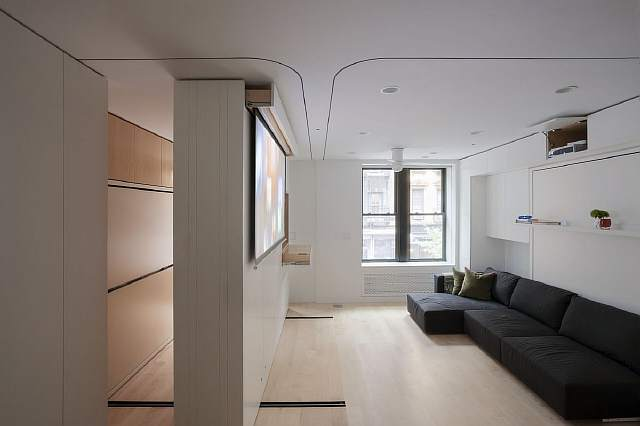 the-extension-wall-also-houses-a-da-lite-projection-screen-and-the-projector-is-neatly-hidden-above-the-couch
