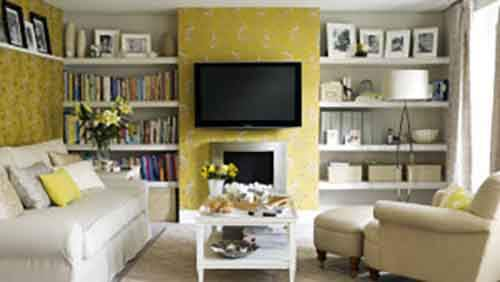 1354180286black-tv-with-chic-yellow-floral-pattern-wallpaper-and-terrific-white-bookshelves
