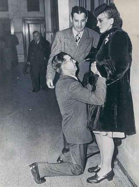 A man begging his wife to forgive him to avoid divorce in the 1940s
