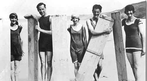 Early surfers with their boards in 1922