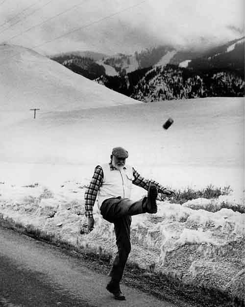 Ernest Hemingway kicking a can in 1959