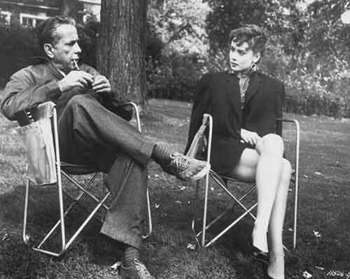 Humphrey Bogart and Audrey Hepburn on the set of Sabrina in 1954