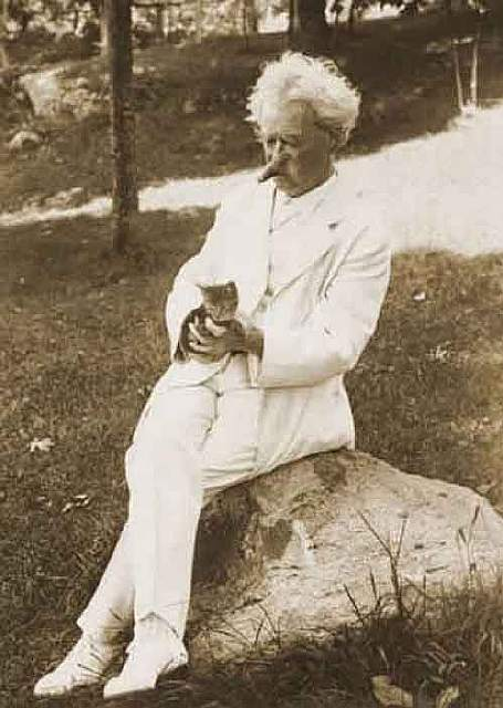Mark Twain befriending a kitten