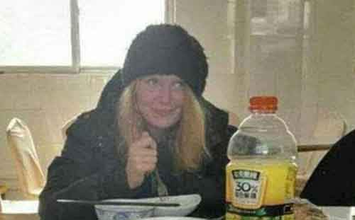 Russian hitchhiker, found starving and penniless while walking along a Chinese expressway