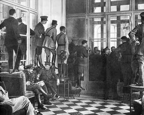 Spectators standing upon tables to get a glimpse of the Versailles Treaty being signed, France, 1919