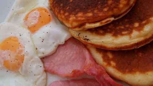 Eggs, toast, bacon or sausage, pancakes, home fries1