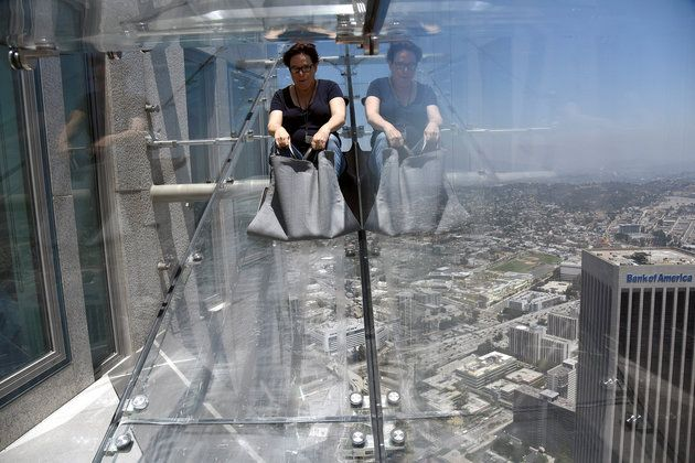 A member of the media rides the Skyslide from the 70th to 69th floor of the U.S. Bank Tower in Los Angeles, California