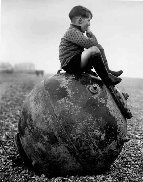 01 - A boy sitting on a sea mine