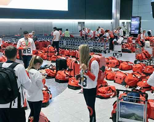 british-olympic-athletes-red-bags-heathrow-airport-5