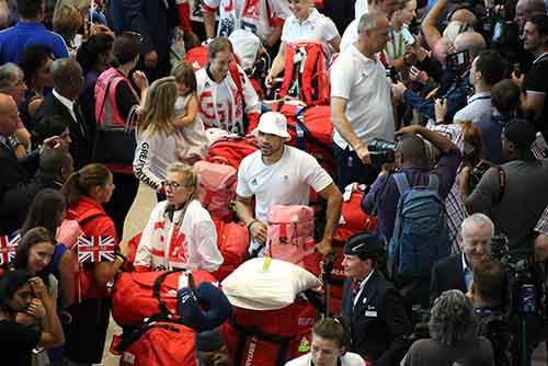 british-olympic-athletes-red-bags-heathrow-airport-8
