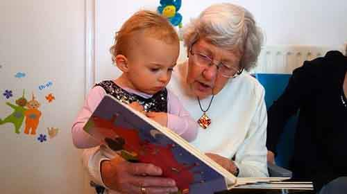 10-grandmother-reading-to-child-610x342