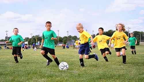 11-kids-playing-soccer-610x346