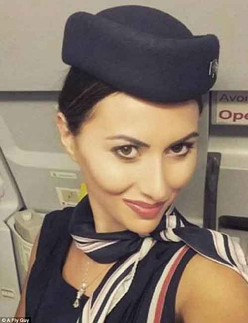 386da2d800000578-3792428-a_greek_aegean_airlines_air_hostess_with_a_coy_pose_and_cheekbon-a-78_1474022020377