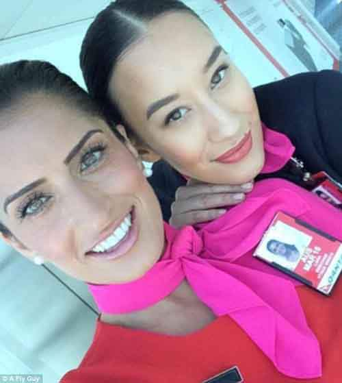 386da2ff00000578-3792428-two_impeccably_groomed_qantas_crew_members_with_bright_pink_scar-a-75_1474021999526