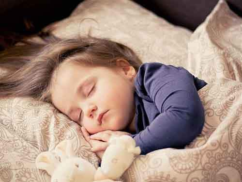 9-little-girl-sleeping-610x457