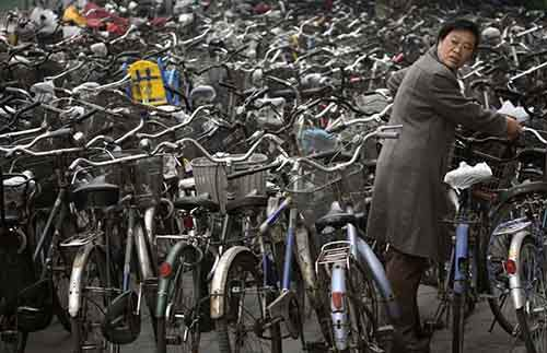 a-woman-collects-her-bicycle
