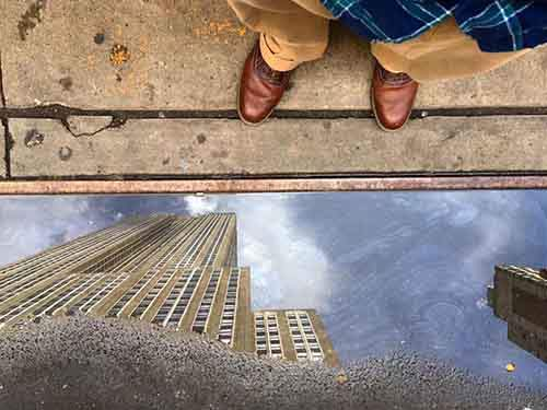 empire-state-building-puddle-reflection-by-ben-hipp
