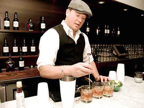 male bartender mixing drinks