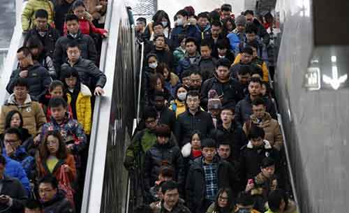 people-ride-escalatorsin-beijing