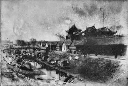 the-old-city-of-shanghai-pictured-here-in-the-1880s-came-complete-with-moat