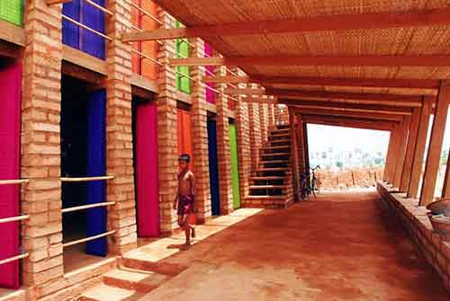 colors-pop-at-the-sra-pou-vocational-school-in-cambodia-villagers-can-visit-the-brick-building-to-learn-arithmetic-or-how-to-start-a-small-business