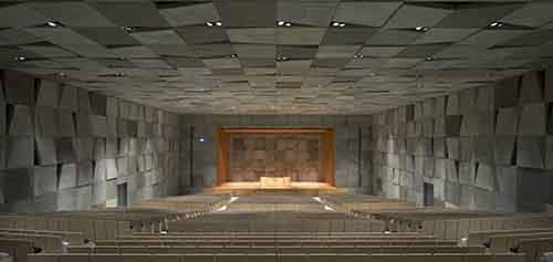the-motif-even-penetrates-the-auditorium-which-has-paneled-gray-walls-and-black-and-white-seats
