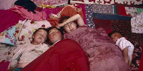 Kazakh children asleep in their kigizuy tent made